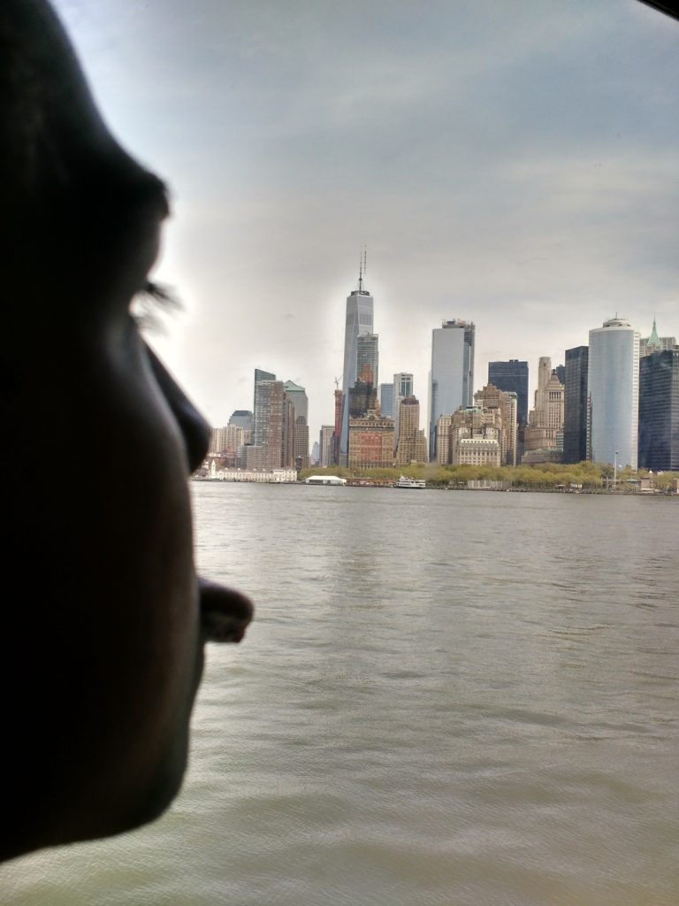 Troy shows his tongue at the New York skyline